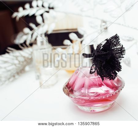 Jewelry table with lot of girl stuff on it, little mess in cosmetic brushes, women interior concept, perfume elegance things isolated