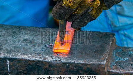 Detailed shot of metal being worked at a blacksmithing forge