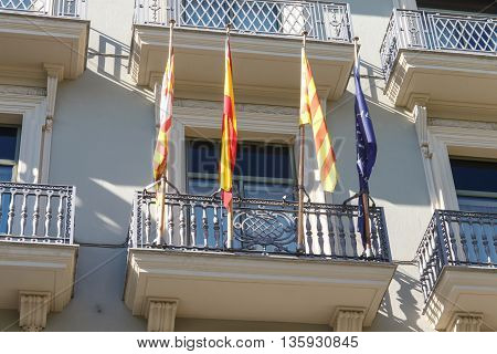 modernist facade building from barcelona with flags
