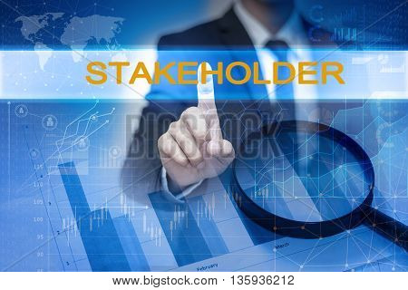 Businessman hand touching STAKEHOLDER button on virtual screen