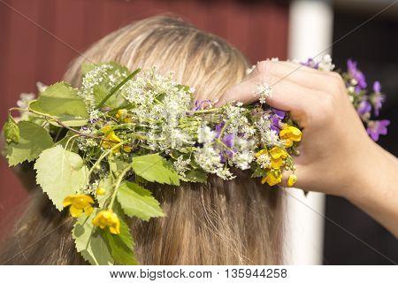 Swedish Midsummer Headgear Traditional on a female head of hair.