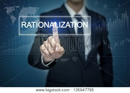 Businessman hand touching RATIONALIZATION button on virtual screen