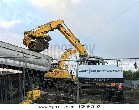 AUCKLAND JUN. 14: Mechanical digger excavator in operation at project construction work site in Auckland New Zealand taken on June 14 2016.
