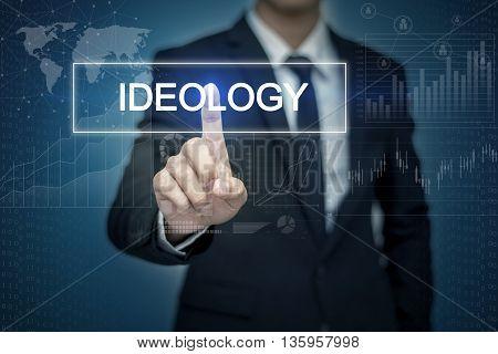 Businessman hand touching IDEOLOGY button on virtual screen