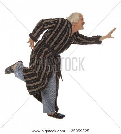 Happy senior man doing chinese qigong gymnastics isolated on white background