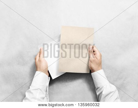 Hand holding blank envelope and kraft letter mockup, isolated. Arm hold clear brochure template mock up. Greeting card leaflet surface design. Invitation print display show. Reading writing envelope.