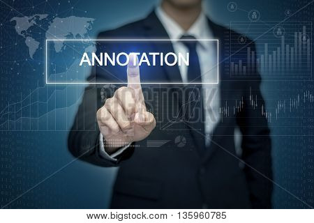 Businessman hand touching ANNOTATION button on virtual screen