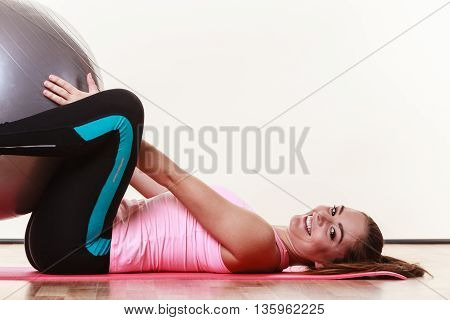 Woman Lying With Fit Ball,
