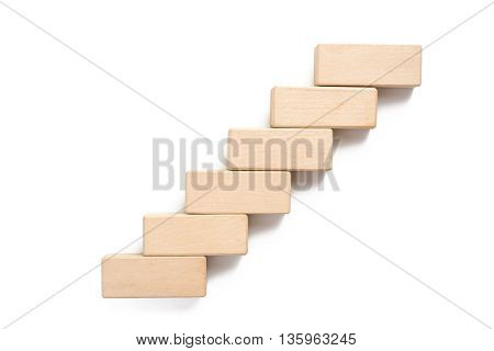 Arranging wood block stacking as step stair. Business concept for growth success process.