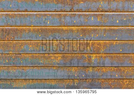 The rectangle tube the rectangle steel tube stack with the rusty in the construction site. The corrosion on the steel tube pile cause of the rust.The rusty texture on the steel pile.