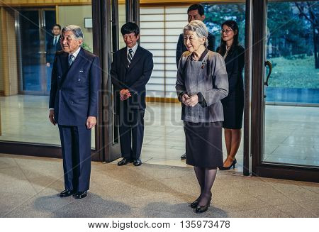 Tokyo Japan - February 26 2015: Emperor of Japan Akihito and Empress Michiko stands in front of entrance to Imperial Residence called Gosho