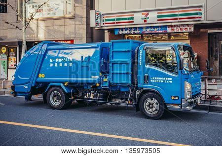 Tokyo Japan - February 27 2015: Blue waste collection vehicle on the street in Tokyo