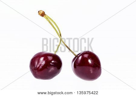 two fruits of red cherry isolated on white background.