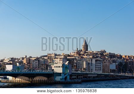 Galata Tower and Bridge with view of Karakoy quarter district. Istanbul Turkey