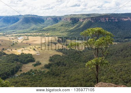 Mountain valley landscape lookout view. Australian outback nature with eucalyptus covered mountains and deforested valley