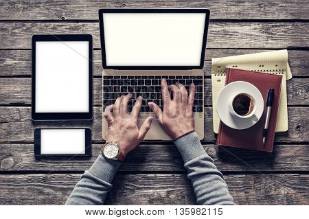 Top view of writer's workplace - laptop and tablet pc with cup of coffee. Clipping paths included.