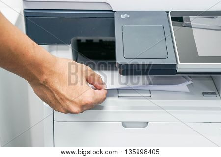 The businessman print and scan the document