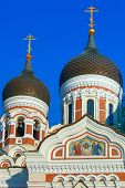 The domes and belfry of Russian Orthodox Alexander Nevsky Cathedral in Old Town Toompea in the evening, Tallinn, Estonia poster