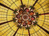 Multi colored stained glass ceiling with flower motif poster
