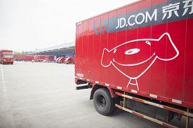 Gu'an, China - June 14, 2016: JD.com trucks receiving incoming goods and preparing shipments at the Northeast China based Gu'an warehouse and distribution facility, Gu'an, China