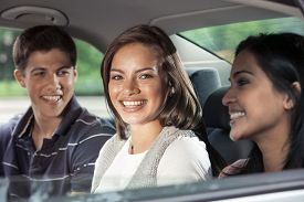 Teenagers riding in car