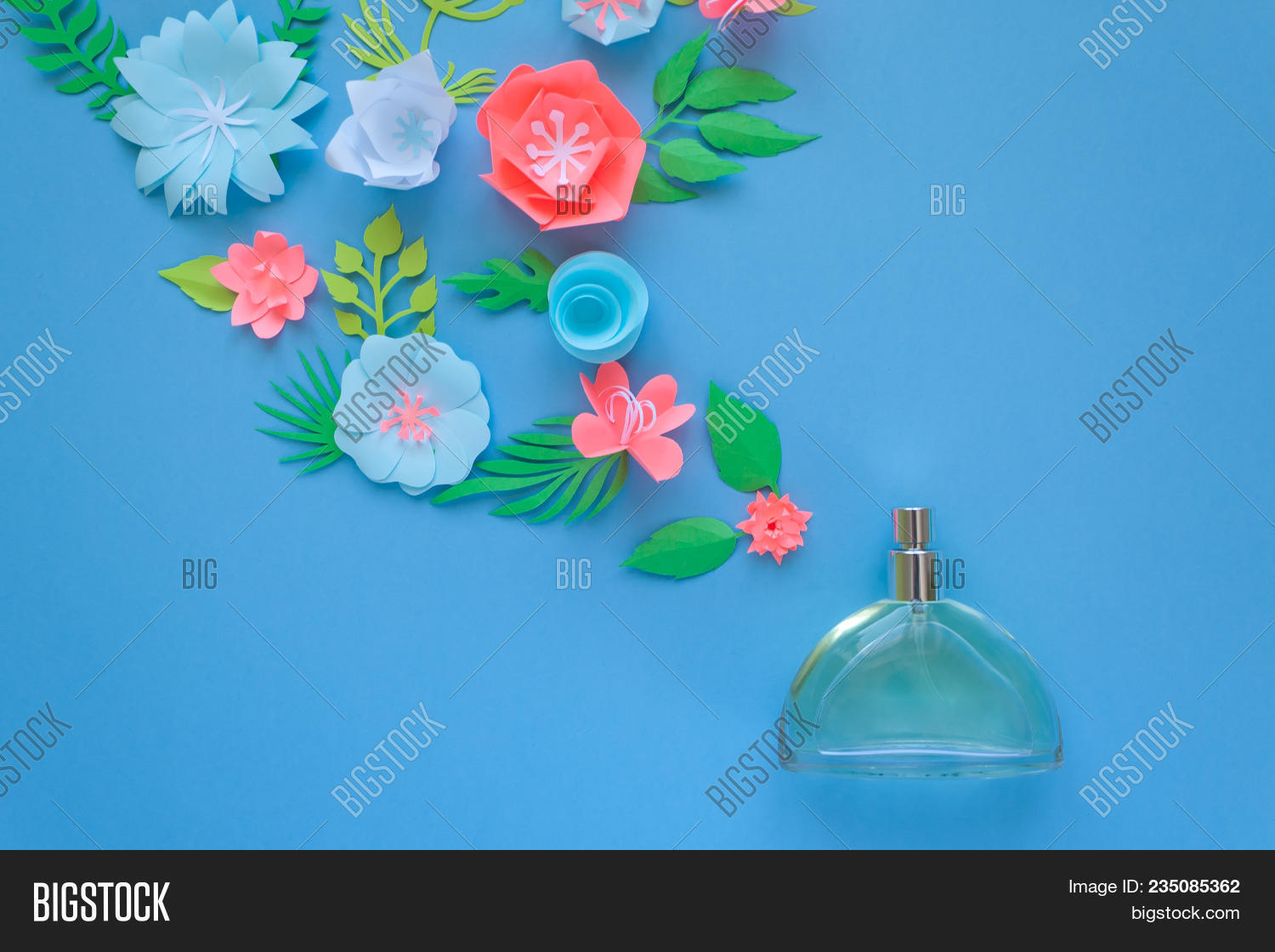 Flower arrangement image photo free trial bigstock flowers fragrance perfume on blue background cut from paper izmirmasajfo
