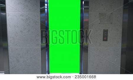 Opening Doors In Elevator With Green Screen. Elevator In Office Building.