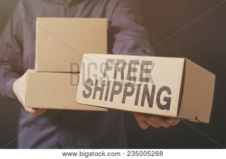 Deliveryman Gives Free Shipping Carton Box. Free Shipping Business Concept.