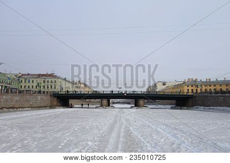 Winter Day And A Walk Along The Ice Of The Fontanka River In St. Petersburg And Semenovsky Bridge