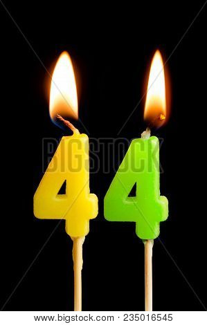 Burning Candles In The Form Of 44 Forty Four (numbers, Dates) For Cake Isolated On Black Background.