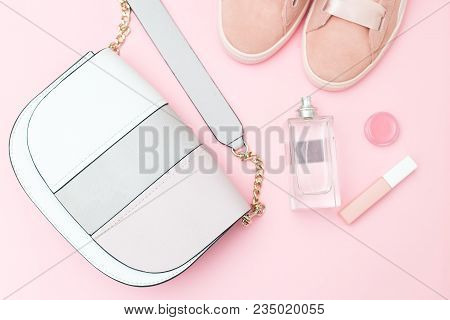 Accessories And Perfumes Of Pink Color On A Pink Background. Flat Lay
