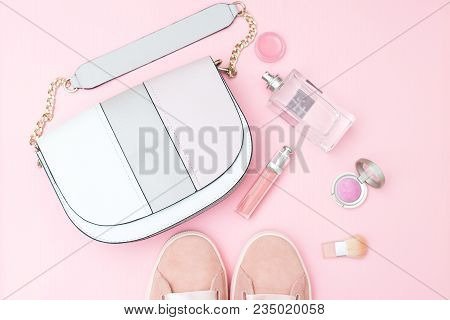 Accessories And Cosmetics Of Pink Color On A Pink Background. Pastel Colors