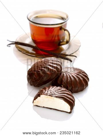 A Chocolate-coated Zefir With Tea. Isolated On White Background.