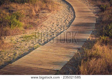 Boardwalk Path Cuts Through Sea Oats On The Mediterranian Coast In Almerimar, Spain