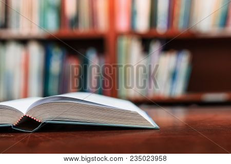 Education Learning Concept With Opening Book Or Textbook In Old Library, Book In Library With Old Op