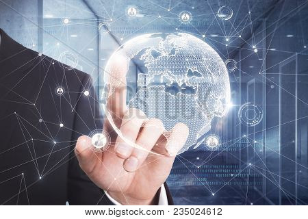 Businessman Hand Pointing At Abstract Digital Globe On Blurry Office Interior Background. Internatio