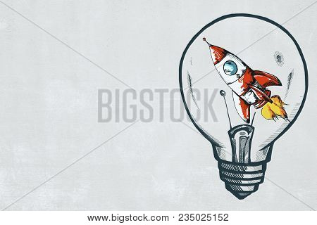 Creative Rocket Lamp Sketch On Concrete Wall Background. Startup And Idea Concept