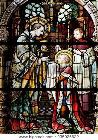 ZAGREB, CROATIA - OCTOBER 02: Saint Aloysius is given his first communion by Saint Charles Borromeo, stained glass window in the church of Saint Martin in Zagreb, Croatia, on October 02, 2017.