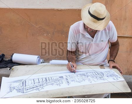 Havana, Cuba - January 16, 2017: Street Illustrator, Drawing The Square Of The Cathedral Of Havana.