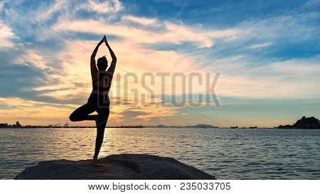 Meditation Yoga Lifestyle Woman Silhouette On The Sea Sunset, Relax Vital. Healthy Concept