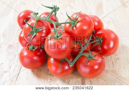 A Cluster Of Small Red Cherry Tomatoes