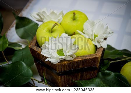 Green Apples In Box Leaf And White Flowers. Green Apples In Old Basket Or Box On Table. Box Green Or