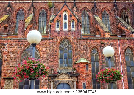 Wroclaw/poland- August 19, 2017: View Of Saint Mary Magdalene Church Facade With Red, Orange And Dar