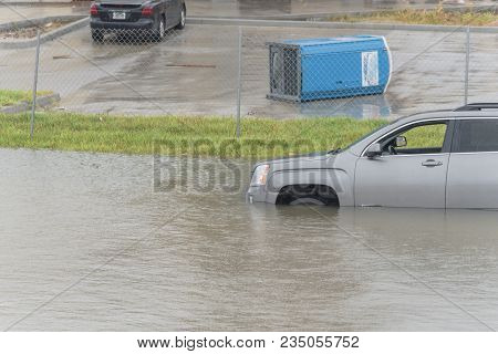 Black Sedan Car Swamped By Flood Water In East Houston, Texas, Usa By Tropical Storm. Submerged Car