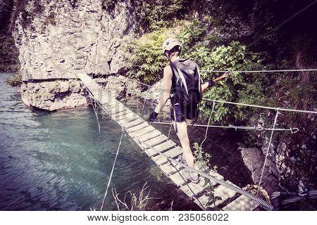 Rope Metal Bridge On Via Ferrata Trail In Mountains, Woman On Footbridge On Ferrata, Dangerous Stret