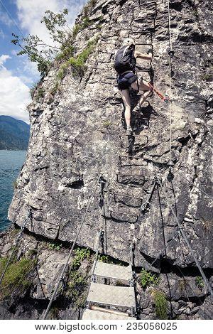 Ladder On On Via Ferrata Trail In Mountains, Rock Climbing, Woman On Ladder On Ferrata, Dangerous St