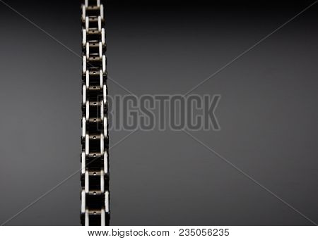 Roller Chain With Sprocket On Dark Background. It Is Used On Cars, Motorcycles, Bicycles And In Mech