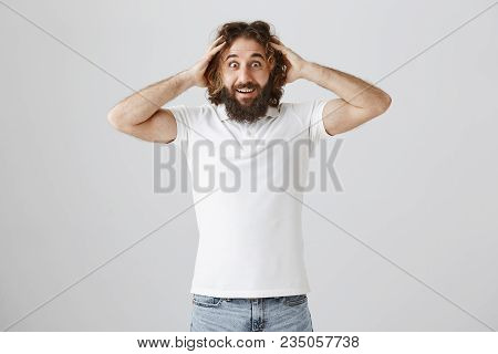 You Must Be Kidding, It Is Success. Astonished And Thrilled Adult Male With Long Beard And Curly Hai