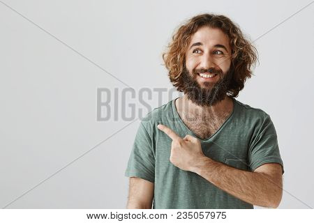 Someday I Will Buy Such Car. Portrait Of Dreamy Attractive Eastern Man With Beard Pointing And Looki