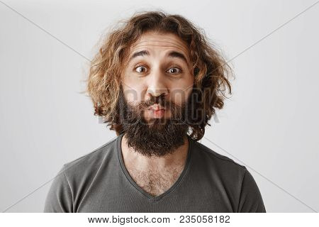 Lonely Man Wants Romance. Studio Shot Of Funny Mature Eastern Male Coworker With Curly Hair Puckerin